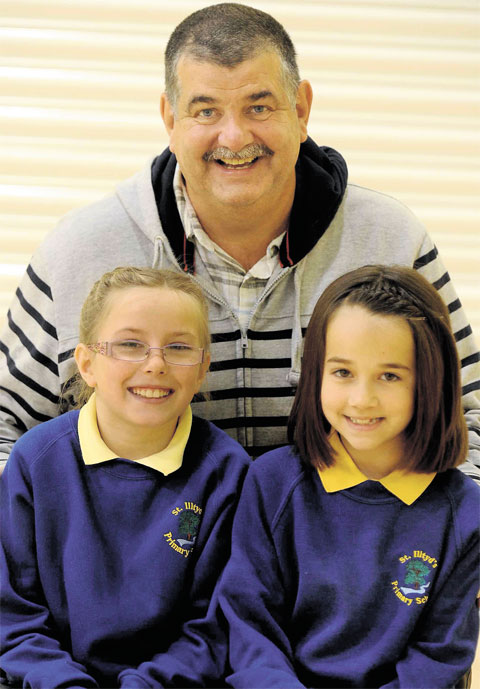 SO GRATEFUL: Jack O'Connell, who lost £500 in a park, was reunited with his cash thanks to these two nine-yearolds, Alysha Beacham, left and Josie Young, both pupils of St Illtyd's Primary School, who found the money and handed it in