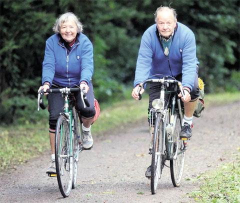 KEEN CYCLISTS: Bette and Graham Cox are celebrating their diamond wedding anniversary