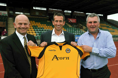 FLASHBACK: Then County chairman Chris Blight, left, and Tim Harris welcome Justin Edinburgh to Spytty Park this time last year