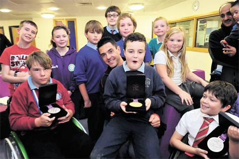 MEDAL HERO: Paralympian Mark Colbourne meets youngsters at the Serennu children's centre
