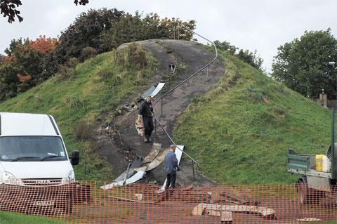 SLIP SLIDING AWAY: The much-loved slide is dismantled by workmen