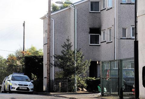 FIRE: Police at the scene of a blaze in Gladstone Road, Brynmawr yesterday