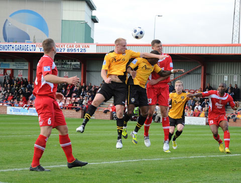 AERIAL BATTLE: County's Lee Minshull and Aaron O'Connor challenge for the ball.