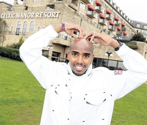 CHAMPION: Mo Farah at the Celtic Manor Resort in Newport yesterday shows off his Mobot Picture: STEVE POPE