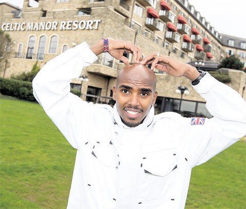 CHAMPION: Mo Farah at the Celtic Manor Resort in Newport yesterday shows off his Mobot Picture: S