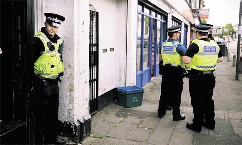 DRUGS BUST: Police outside the house in Corporation Road, Newport Drug den heroin user must wait to hear about his punishment