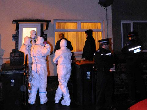 SCENE: Police and forensics officers at the house on Ailesbury Street, Crindau on Tuesday