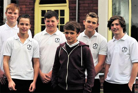 TEEN HELPERS: Pupils, from left, Tudor Williams, Josh Keen, Jake Thomas, Perry Jones, Chad Ward and Bradley Leeder who came to the assistance of Mr Wifred Bridges (89) who collapsed outside his home