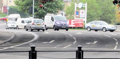 WRONG WAY: The silver hatchback goes anticlockwise around the roundabout