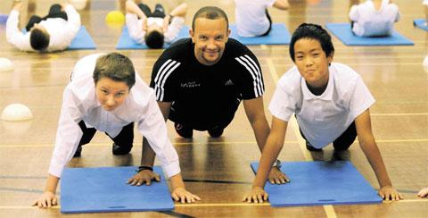 KEEPING FIT: Jamie Baulch works out with pupils Joseph Pearce, left, and Prabesh Fagu