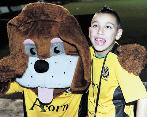 TOP DOGS: Newport County mascot Ethan Jolosa meets Spytty the Dog at Rodney Parade