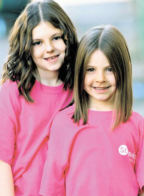 HAIR RAISING: Alena Griffiths, left, and friend Jessica Green show off their haircuts above after getting the chop to raise money for charity