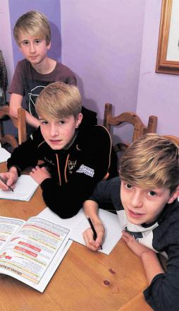 WORKING AT HOME: Finlay and Harvey Reader and fellow pupil Alex Spencer Classes resume for some after asbestos scare, while other pupils are taught online