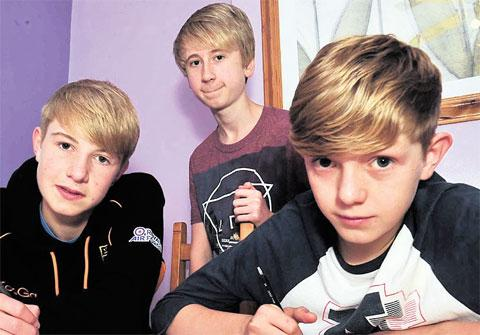 CONCERN: Martyn Reader's sons Finlay, 13, and Harvey, 15, working at home with fellow pupil Alex Spencer