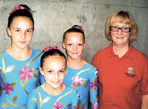 AFFECTED BY CLOSURE: Cwmcarn gymnastics coach Mary Penny with some of her star pupils, Kira Sparkes, Olivia Hillman and Allana Sparkes