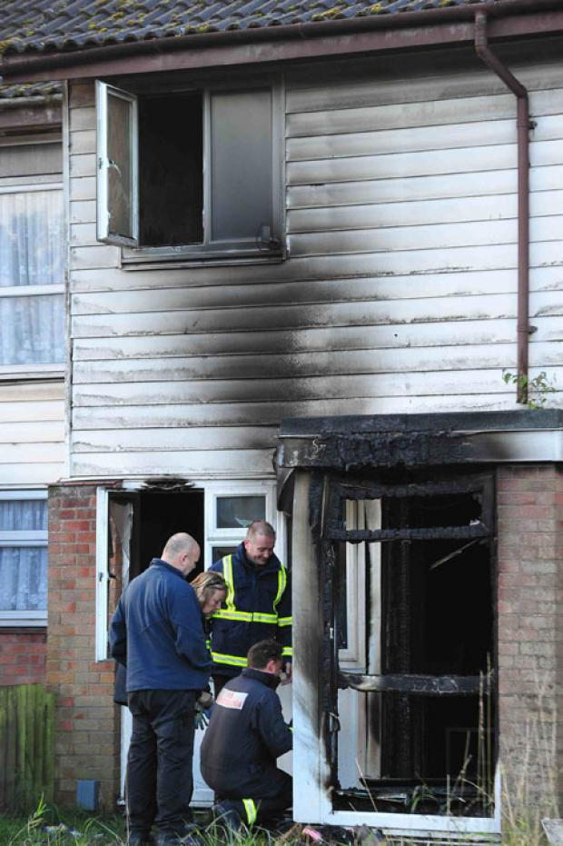 SCENE: The charred house on Broadmead Park in Newport