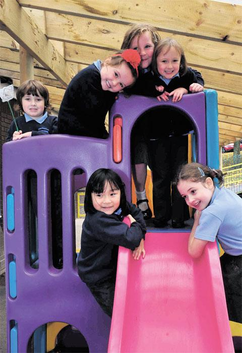 GREAT OUTDOORS: Pupils having fun in an outdoors play area at Griffithstown Primary School