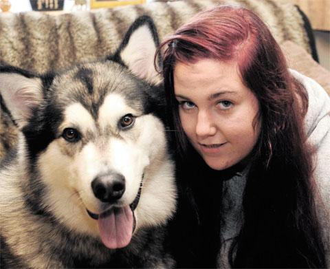 TALKIES: Jess Crombie from Newport with Jake who, according to his owner, can say 'I love you