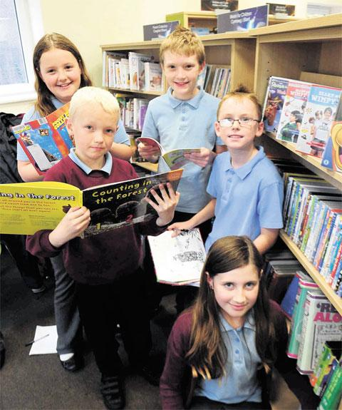 BOOKWORMS: Abercarn Primary pupils Chloe Heaven and Ellis Cleland (rear) with Jordan Cheshire and Connor Parry (centre) and Ceinwen Bowen