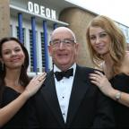 South Wales Argus: SMITH, STAN SMITH: Flanked by 'Bond girls' Amy Dorgan and Kate Paszkowec at the Odeon.