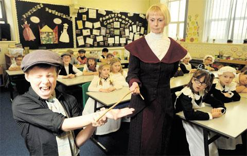 BAD OLD DAYS: Joseph Davies is 'caned' by Miss Keeling