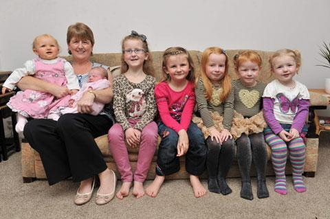 SEVEN-TIMES GRAN: Judith Benger holding Katie benger, 11 months and Hallie Benger, 3 months and sat next to (L-R) Aimee Benger, 7, Jessica Benger, 6, Lily Smith, 4, Erin Smith, 3, Hannah Benger, 2