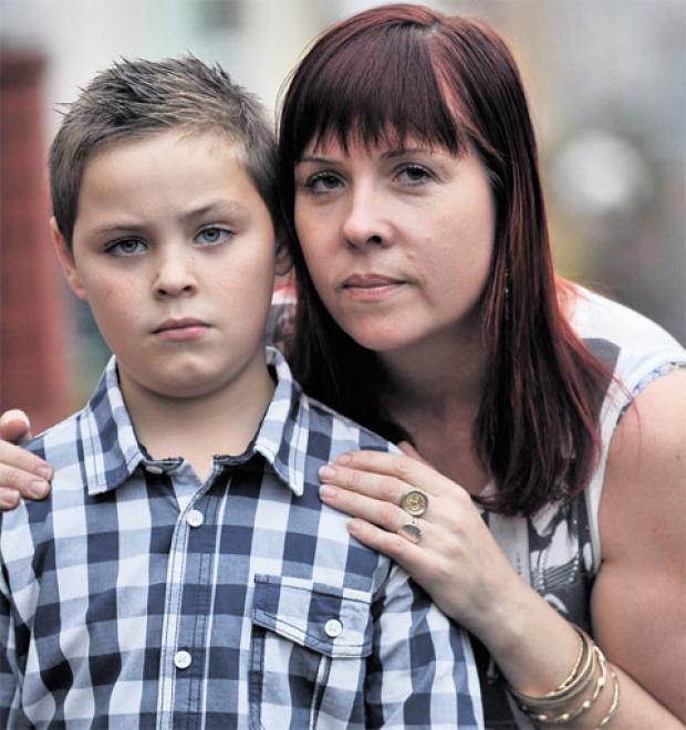 MUGGED: Daniel Farmer, whose birthday iPod was stolen, pictured with his mum Annette