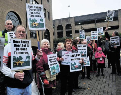 MAKING THEIR POINT: Members of Torfaen Friends of the Earth protesting against the planned development