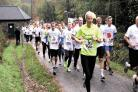 AND THEY'RE OFF: The runners set off on the Great Gwent Poppy Run at Cwmcarn Forest Drive
