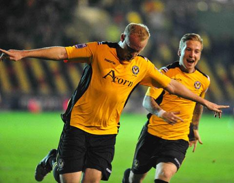 DELIGHT: Lee Minshull celebrates after scoring County's first goal tonight