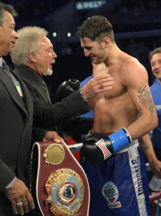 WHAT'S NEW PUSSYCAT? Nathan Cleverly celebrates retaining his WBO light-heavyweight title with Welsh compatriot and singer Sir Tom Jones