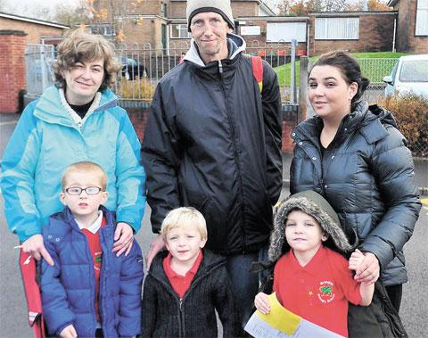 UNHAPPY: Sue Williams with son Thomas, Gordan Williams with son Ethan and Nicola Hayes with son Alexander outside Brynglas Primary