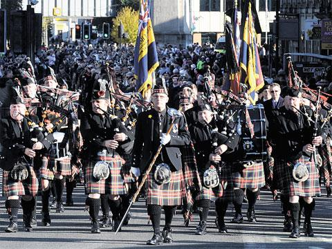 RAISING MONEY: The Newport marching pipe band, pictured, in Newport this year, want to buy a plaque in memory of a band member who died
