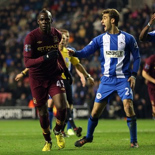 Mario Balotelli, left, scored his first league goal of the season against Wigan