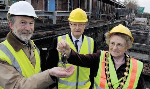 KEY MOMENT: Cllr Maureen Powell hands over the Raglan railway station keys to Gerallt Nash, senior curator at St Fagans National History Museum. Looking on is Bob Greenland, Monmouthshire council deputy leader
