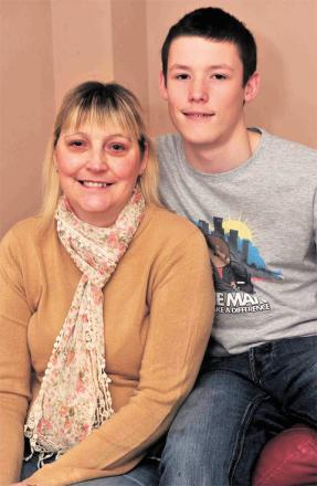 BACKING CAMPAIGN: Janet Rogers of Afon Village, Rogerstone had a lifesaving double lung transplant 12 months ago. She is pictured with her son Wil