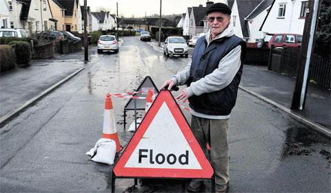 FED UP: William Plamer by the flooded road that is causing misery to Rogerstone residents