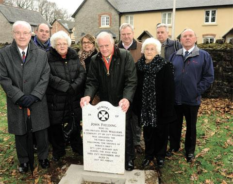 South Wales Argus: DELIGHTED: Members of the John Williams (Fielding) Memorial Trustees with the new gravestone