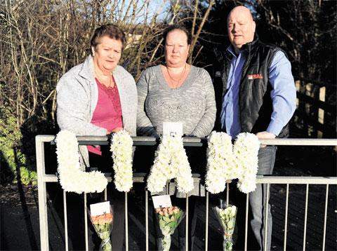 TRIBUTE: The family of Liam Gasson, aunt Michelle Gassson, dad Perry Gasson and grandmother Janet Gasson, attach a floral tribute at the spot where he died in an accident four years ago