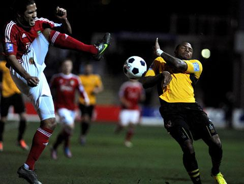 South Wales Argus: FINE GAME: County's Aaron O'Connor shields himself from the ball during tonight's game