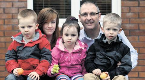 HEALTHY EATERS: A Pontypool family is fronting the Welsh Government's Change4Life programme dad Steve Betts with Ethan, 3, Briony, 14, Gracie, 3 and Ashley, 3