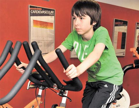 KEEPING FIT: Ioan James, 11, tries out the gym equipment at the Unique Health and Fitness gym in Blackwood