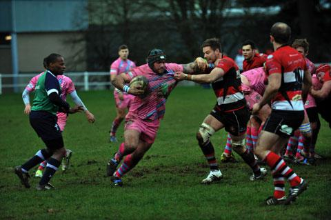 ON THE CHARGE: Ebbw Vale's Spencer Gibson takes on Pontypool's Mike Barber