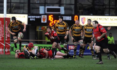 POETRY IN MOTION: Cross Keys scrum half Ryan James gets the ball away sweetly PICTURE: CHRIS TINSLEY