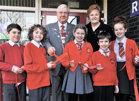 TEAMWORK: Left to right, Morgan Healey, nine, Thomas Godsell, ten, Elizabeth Wall, ten, Dylan Zorrilla, ten, and Evie Morgan, ten, help deputy mayor of Newport Cllr Cliff Suller and presiding officer of the Welsh Assembly Rosemary Butler cut the opening r