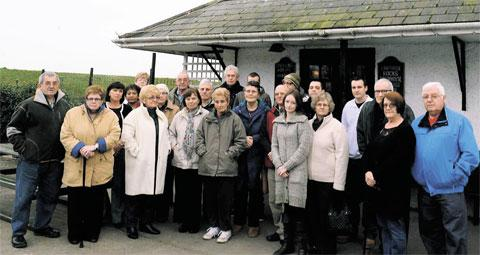 PAYING THE PRICE: Residents, workers and regulars outside the Lighthouse Inn, St Brides