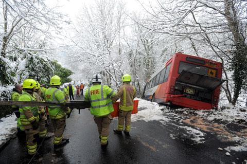 LUCKY ESCAPE: The bus is hauled back up the embankment in Abercarn