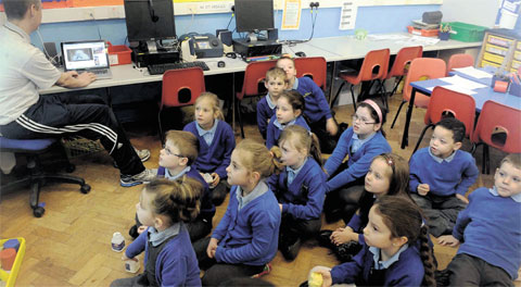 WE TURNED UP: Pupils at Gaer Infants School in their classroom yesterday