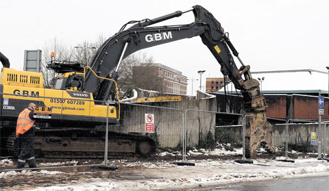DEMOLITION STARTS: Workers on site at the Cambrian multi-storey car park in