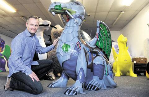 POPULAR: John Williams, one of the SuperDragon artists with his Cyber dragon at Urban in Newport in June 2012
